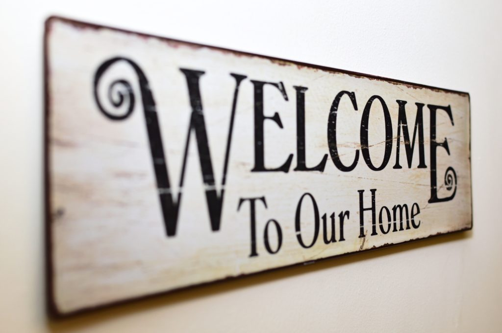 A welcome to our home wall sign