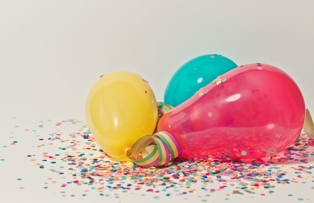 Balloons on a bed of coloured confetti